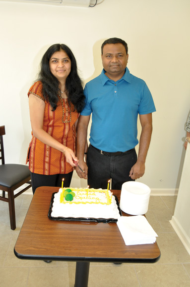 Asmita and Yah Patel, of Lowndesboro, served cake to guests to mark the grand opening of their Champs Chicken franchise in Lowndesboro last Monday.