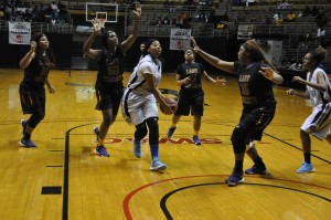 Central's Kentravious Dudley 23 and a Calhoun Lady Tiger were in action Friday in the Class 2-A semifinal regional action at the Dunn-Oliver Acadome on Friday.