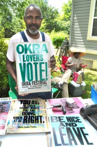 Famous poster artist Amos Paul Kennedy shows off the latest Okra Festival poster.