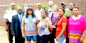 Lowndes County law enforcement officials, District Attorney Charlotte M. Tesmer and family members of Mosses double homicide victims Frank James Hill, 26, and Antoni Markee Means, 36, gather for a press conference to announce $6,000 in reward money at the John Hulett Detention Facility in Hayneville.