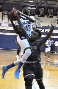 Jakobe Miles goes airborne for Calhoun in the 2A Area 6 boys varsity basketball championship game played at Calhoun, Friday, Feb. 9. Fred Guarino/The Lowndes Signal.