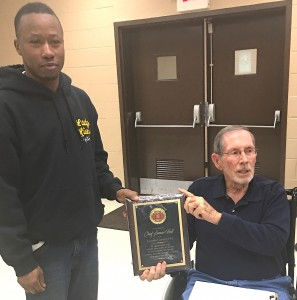 Lamar Hall, who recently stepped down as fire chief of the Burkville Volunteer Department receives a plaque for more than 20 years of service from Rodney Rudolph, president of the Lowndes County Association of Volunteer Fire Departments. Rudolph also gave Hall lifetime firefighter status. Submitted.