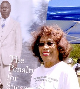 """Josephine Bolling McCall, author of """"The penalty for Success: My Father Was Lynched in Lowndes County, Alabama"""" with an image of her father, the late Elmore Bolling. Bolling was a black entrepreneur and philanthropist whose successful business interests led to his being killed at the age of 39 on Dec. 4, 1947., and he is among the Alabama martyrs of the Civil Rights Movement. The Elmore Bolling Legacy Luncheon will be Saturday, June 16 in White Hall."""