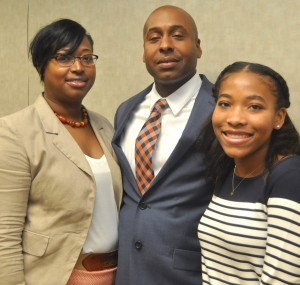 Newly hired Lowndes County Public Schools Superintendent Jason Burroughs with his wife, Freda, left, and his daughter, Jada, right. Burroughs was unanimously selected by the Lowndes County Board of Education as the system's new school superintendent following a special called meeting and interview process held Tuesday, Aug. 21 at the central office in Hayneville. Signal photo/Fred Guarino.