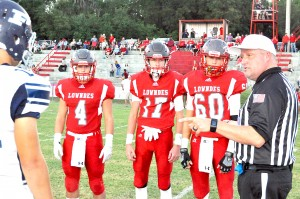 Lowndes team captains for Patrician are from left Mason McCurdy (4), Zack Miller (17) and Daniel Calloway (60).