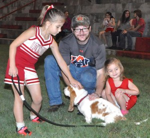 New Rebel Mascot? At left is Cailin Blankenhorn, petting her dog, Cash the basset hound, with James Thomas, center, and Tallulah Thomas, right.