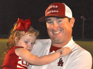 Lowndes Academy head football coach Shane Moye with his daughter, Pearsyn.