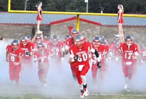 Rebels rush onto the field through a curtain of smoke to face Patrician in their first regional contest of 2018.