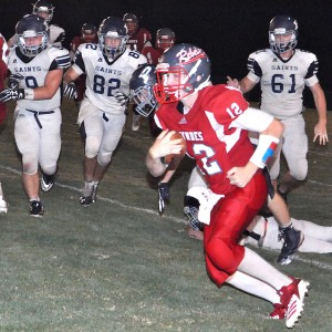 Tyler Smith (12) is pursued by the Patrician Saints.