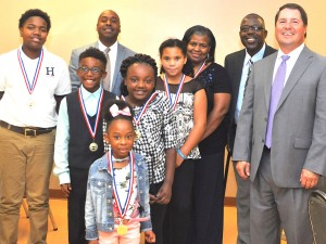 Lowndes County School Superintendent Jason Burroughs, Pastor Sylvester Hardy of Jonathan's House of Prayer in Hayneville and Lowndes County District Judge Adrian D. Johnson join Lowndes County Public School Character in Action honorees at the annual CIA Banquet held at the Hayneville Senior Center on Thursday, Sept. 27. Pictured are Kaden Williams, Khassidi Webb Isabella Bella, Myia Porterfield and Ja'Carie Shuford. Jaylan Gary was represented by her mother, Antonette Gary. Signal photo/Fred Guarino.