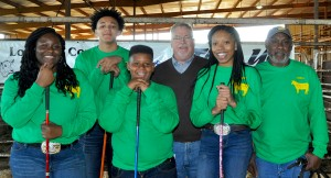 Lowndes Youth Livestock Winners Winners were announced Sunday, Feb. 24 at the Lowndes County Youth Livestock Show held at Mid-State Stockyards in Letohatchee. Pictured from left are Daraja Mae, Coleman Hunter, Bryan Lambert, Livestock Show Jude Van Smith of Autauga County, Christy Daniel and Lowndes County Commission Chairman Carnell McAlpine. Signal photos/Fred Guarino.