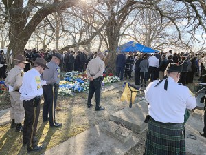 """Law enforcement officers from all over the State of Alabama, family members and friends bow their heads in prayer following the playing of """"Amazing Grace"""" by a Calhoun County Sheriff's Office Honor Guard member Monday afternoon at McQueen Cemetery in Hayneville where Lowndes County Sheriff John """"Big John"""" Williams was laid to rest after he was fatally shot Nov. 23. 